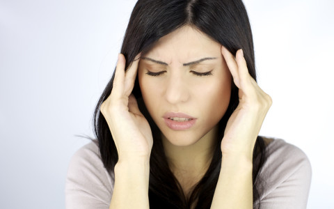 Closeup of woman with strong headache
